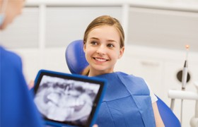 Smiling preteen girl in dental chair