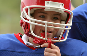 Young boy in football uniform