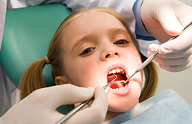 Little girl receiving dental exam