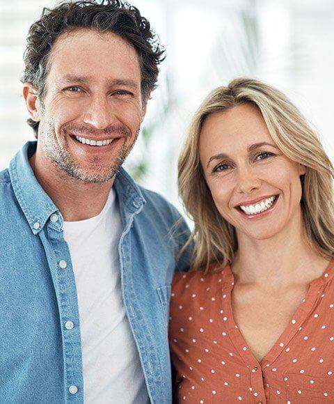 Happy couple with healthy smiles