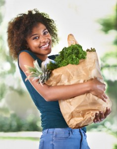 Woman with healthy foods to improve her oral health thanks to the dentist Aurora loves