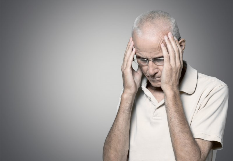 Man concerned with head